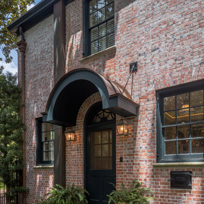 Inspiration for a mid-sized timeless two-story brick exterior home remodel in Houston with a hip roof