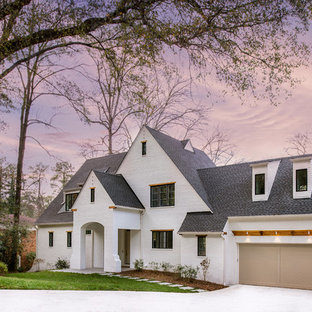 Large transitional white two-story brick gable roof photo in Atlanta with a shingle roof