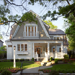 Large traditional gray two-story wood house exterior idea in DC Metro with a gambrel roof and a shingle roof