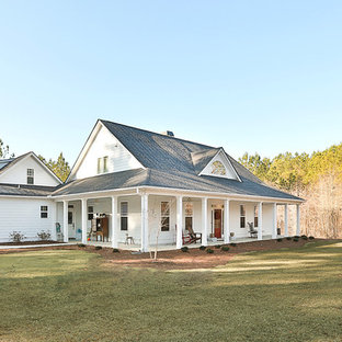 Inspiration for a mid-sized farmhouse white two-story concrete fiberboard exterior home remodel in Atlanta with a shingle roof