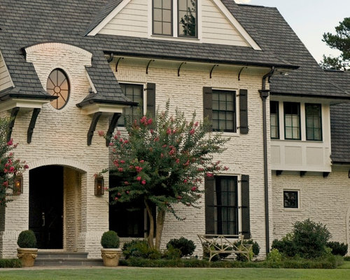 Lovely Mid Sized Elegant Beige Three Story Brick Exterior Home Photo In Atlanta  With A