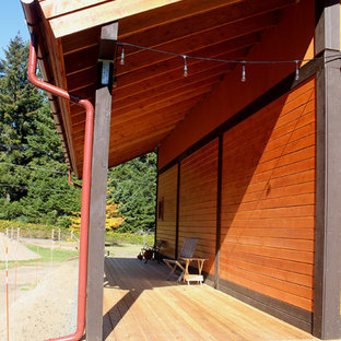 Mid-sized cottage brown two-story wood exterior home photo in Seattle with a metal roof