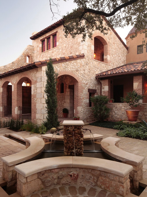 fountain designs for home. example of a tuscan stone exterior home design in austin fountain designs for