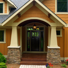Traditional Exterior by Homes By True North