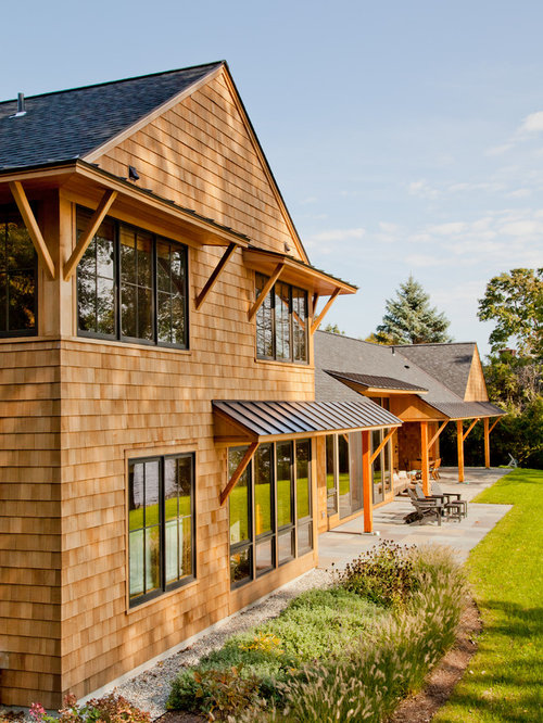 Example Of A Mountain Style Two Story Wood Gable Roof Design In Burlington  With A