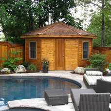 Eclectic Exterior by Forest Fence & Deck Co Ltd.