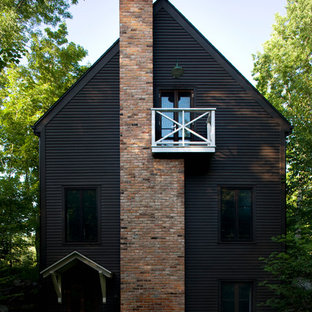 Inspiration for a scandinavian two-storey black exterior in Montreal.