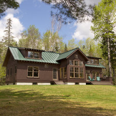 Rustic Exterior by Bennett Frank McCarthy Architects, Inc.