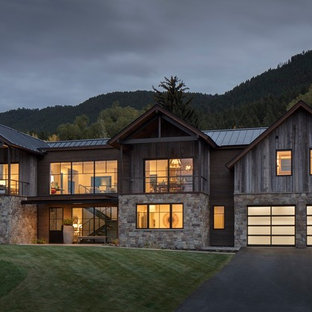 Inspiration for a large rustic gray two-story mixed siding gable roof remodel in Other with a metal roof