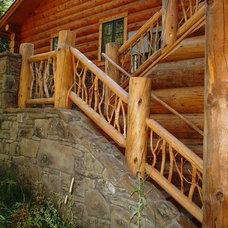 Rustic Exterior by Teton Heritage Builders