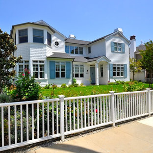 Inspiration for a beach style two-storey white house exterior in Los Angeles with wood siding.