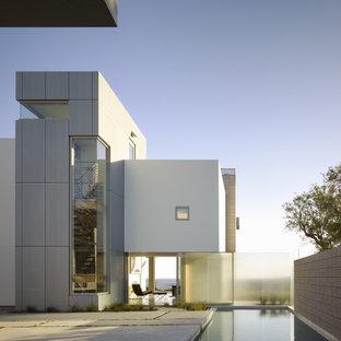 Inspiration för moderna hus, med metallfasad och platt tak