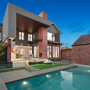 Large transitional two-storey brick multi-coloured exterior in Melbourne.