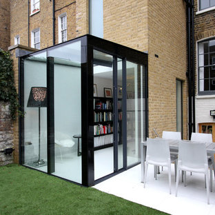 Photo of a small and beige modern one floor glass exterior in London.