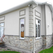 Traditional Exterior by OakWood Renovation Experts