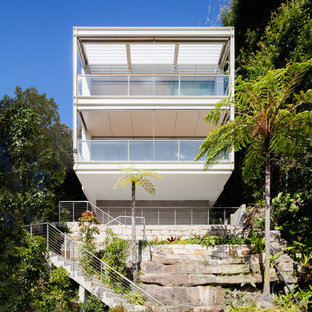 Inspiration for a modern two-storey white house exterior in Sydney with a flat roof.