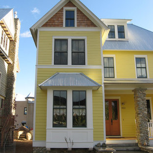 Inspiration for a mid-sized victorian three-story wood exterior home remodel in Charlotte with a metal roof