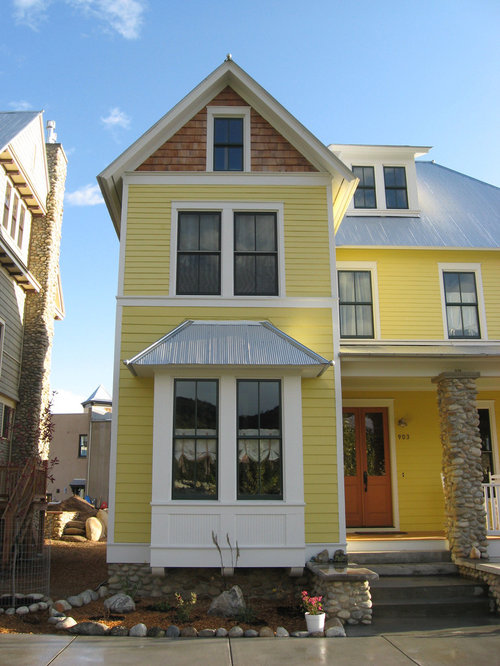 inspiration for a midsized victorian threestory wood exterior home remodel in charlotte