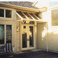 Traditional Exterior by Solarium/Skylight Inc