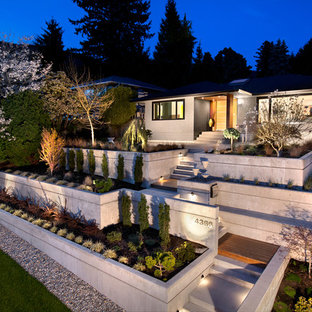 This is an example of a medium sized and gey midcentury two floor concrete detached house in Vancouver.