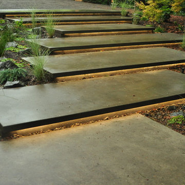 Cantilevered concrete stairs w/ lighting underneath