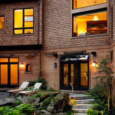 Contemporary Exterior by Gustave Carlson Design