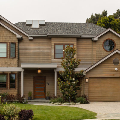 Transitional brown two-story wood exterior home photo in Los Angeles with a shingle roof