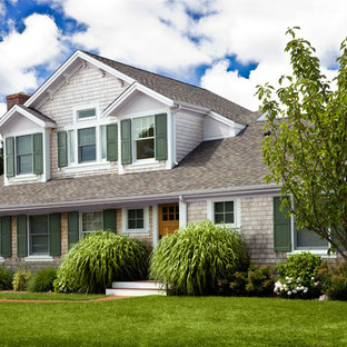 Inspiration for a timeless two-story wood exterior home remodel in Providence