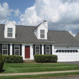 Elegant white two-story exterior home photo in Bridgeport