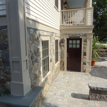 Cape Cod Inn with New England Stone Cladding, Retaining Walls, and Water Feature