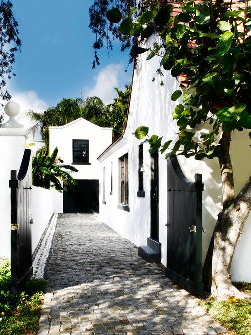 Tuscan white exterior home photo in Miami