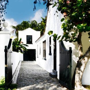 Photo of a white mediterranean house exterior in Miami.