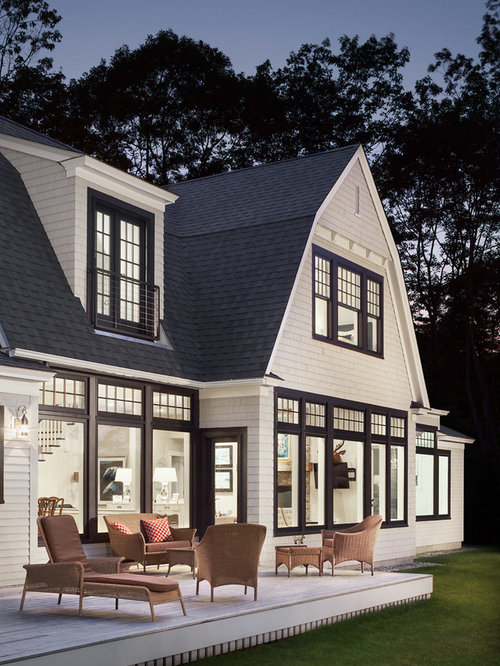 coastal white two story wood exterior home photo in portland maine with a gambrel roof