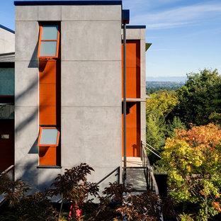 Contemporary concrete exterior home idea in Seattle