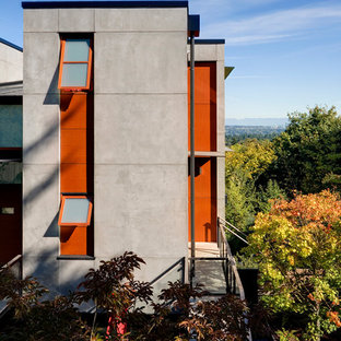Design ideas for a contemporary concrete exterior in Seattle.