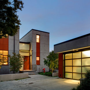 Inspiration for a mid-sized contemporary gray two-story concrete flat roof remodel in Seattle