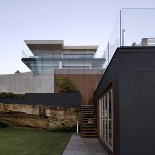 Example of a trendy black two-story mixed siding exterior home design in Sydney