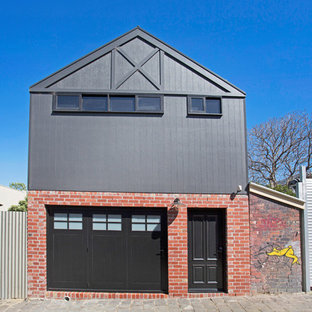 Photo of a transitional two-storey grey house exterior in Melbourne with mixed siding and a gable roof.