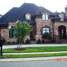 Traditional Exterior by Unique Homes Construction
