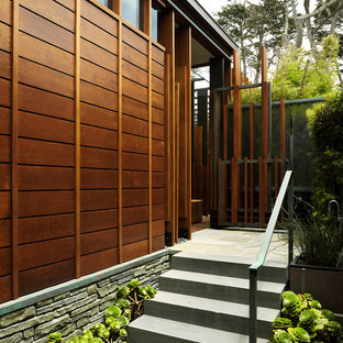 Inspiration for a modern stone exterior home remodel in Chicago