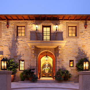 Design ideas for a mediterranean two-storey exterior in San Francisco with stone veneer.