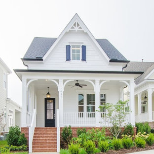 Inspiration for a timeless white one-story exterior home remodel in Nashville with a shingle roof