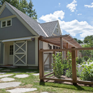 Photo of a gey rural exterior in Boston with wood cladding.