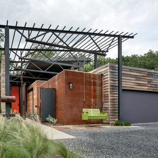 Inspiration for a small industrial multicolored one-story mixed siding exterior home remodel in Dallas with a shed roof