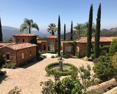 Tuscan Brown One Story Gable Roof Photo In Los Angeles With A Tile Roof