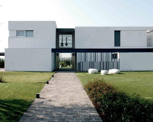 Foto e idee per facciate di case facciata di una casa for Casa moderna bologna