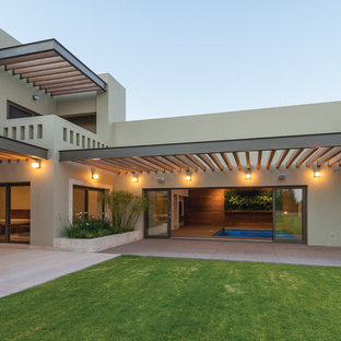 Example Of A Minimalist Two Story Exterior Home Design In Other