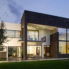 Contemporary Exterior by Gilberto L. Rodriguez / GLR Arquitectos