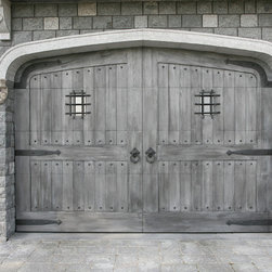 Castle - View of castle garage doors, which were electrically opened, but made to look like stable doors. The exterior metal hardware is hand forged by Artist Blacksmith Jeff Benson.