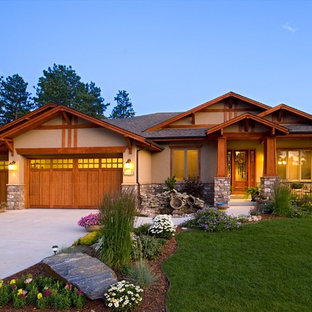 Example of an arts and crafts one-story gable roof design in Denver